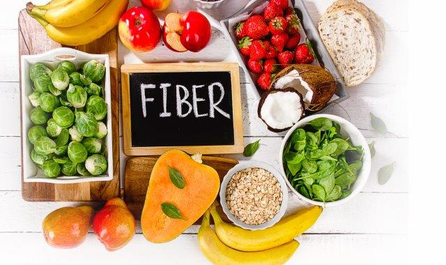 Fiber items with a chalkboard in center with the word fiber written on it